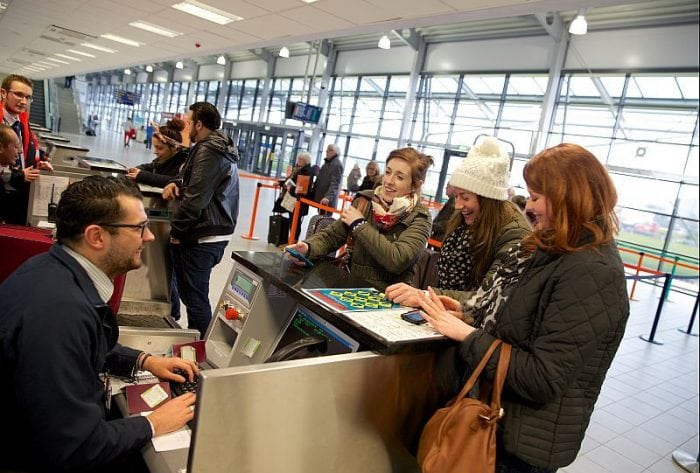 Passengers happily checking in at London Southend Airport