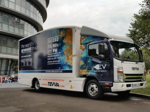 Exterior shot of Tevva electric truck beside building