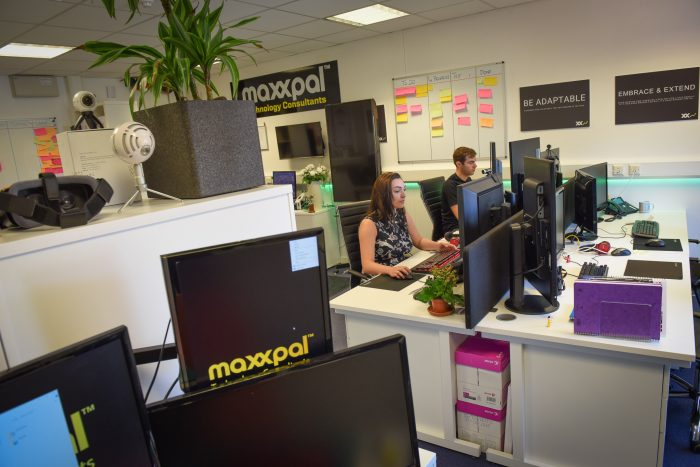 Workers in Maxxpal office